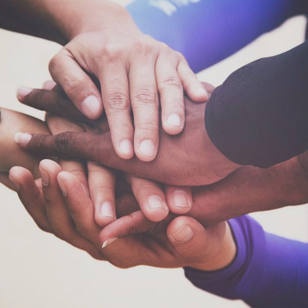 diverse-group-of-people-holding-hands-in-supportive-gesture_t20_QQbmOW-scaled-1.jpg